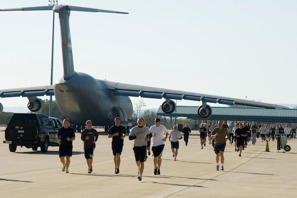 Airmen run the perimeter of the flight line at the 167th Airlift Wing during the unit's fourth annual Veterans Day 5K run, Sunday, November 7, 2009. The 3.1 mile course winds around the units recently completed aircraft ramp and other newly constructed buildings at the base.
