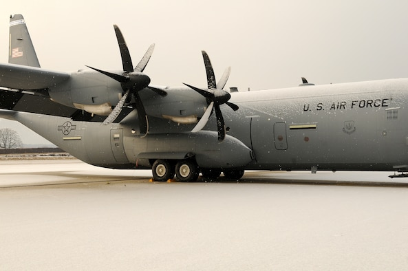 Snow clings to a C-130J as inclement weather descends on Ramstein Air Base, Germany, January 7, 2010. (U.S. Air Force photo by Airman 1st Class Brea Miller)