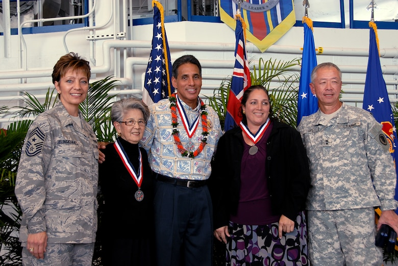 (L-R) Elaine Ota, Lt. Gov. Duke Aiona Jr. and Lorna Souza receive Center of Influence awards from Command Chief Master Sgt. Denise Jelinski-Hall and Maj. Gen. Robert Lee during the Hometown Heroes Ceremony here Dec. 6, for their support of the troops.