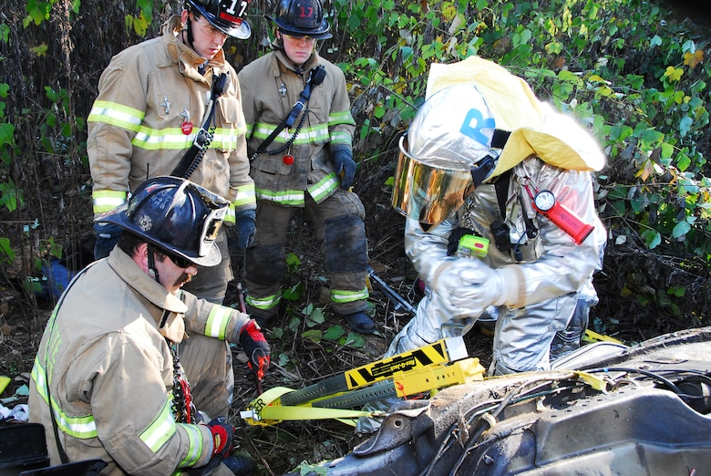 Charlotte Air National Guard Base, NC – Using hydraulic-powered tools, emergency responders from North Carolina Air National Guard's 145th Civil Engineering Squadron work with contemporaries from the Charlotte Fire Department to extricate passengers of a car during a simulation exercise conducted here recently.  The exercise replicated an event encountered while the unit was deployed in Iraq, in which a vehicle was discovered upside-down at the bottom of a ravine.  The North Carolina Air National Guard responds to in-state emergencies, EMAC designated contingencies and federal instances of homeland defense.  The unit currently has members deployed I support of Operations Enduring Freedom and Iraqi Freedom and continues to support the War on Terror. Photo by Staff Sgt. Richard Kerner