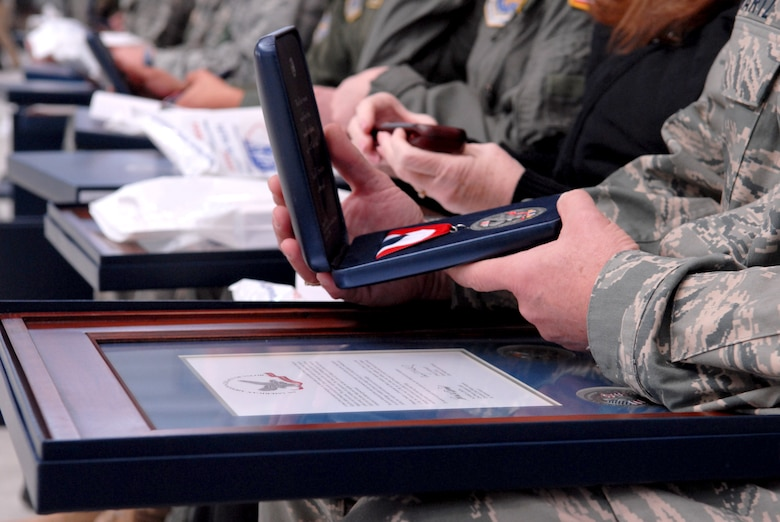 Airmen from the 167th Airlift Wing look at the various items they were presented during the units first Hometown Heroes Salute recognition program on Sunday December 6, 2009. In August 2008, Gen. Craig R. McKinley, chief of the National Guard Bureau, sanctioned the ANG Hometown Heroes Salute recognition program. The purpose of this program is to celebrate and honor Airmen, families, communities and those special supporters who have significantly contributed to supporting our Airmen and ANG?s mission. (U.S. Air Force photo by SSgt Julie Lozinski)