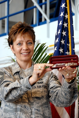 Command Chief Master Sgt. Jelinski-Hall displays gift given to each 