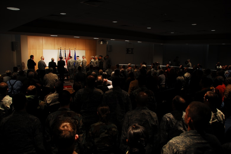 North Carolina Air and Army National Guard members salute during opening ceremonies at the new training and support facility,145th Combat Operations Group. Photo by Tech. Sgt. Brian E. Christiansen, 145th AW Public Affairs