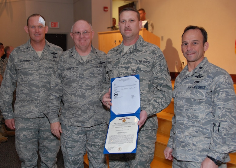 Master Sgt Chuck Davis, NCOIC of the Communications/Navigation section, was one of several Airmen awarded the Air Force meritorious service medal for his leadership and many years of dedication.  Honoring him are Col. David Zartman, Brig. Gen. Iwan Clontz, and Lt. Col. Lance Press. Photo by Master Sgt. Keith Dennis, 145th AW Public Affairs