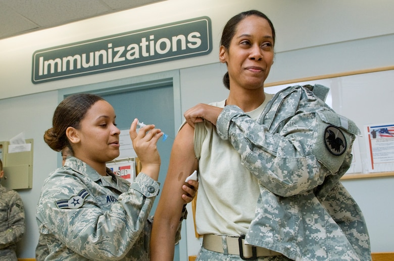 An Airman at Hanscom Air Force Base, Mass. receives a flu vaccination. All Airmen must receive a flu vaccination every year, before January 1, to keep their individual medical readiness current. (U.S. Air Force photo by Mark Wyatt)