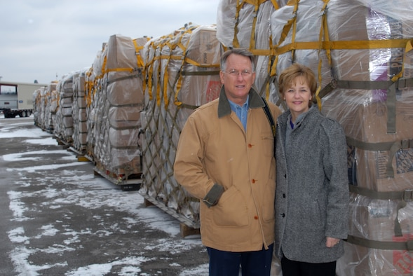 Retired Lt. Gen. John Bradley and wife Jan, who founded the Lamia Afghan Foundation, stand by a pallet at the 118th Airlift Wing. The pallets are loaded with humanitarian aid to send to people in Afghanistan. More than 60,000 pounds of aid are to be flown to Afghanistan Mid-January 2010. The foundation cooridinated the loading and delivery of the pallets.