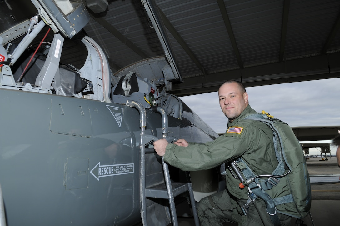 C.B. Hudson, lead guitarist for Blue October, climbs into the cockpit of a T-38 at Randolph Air Force Base, Texas, before his orientation flight Jan. 12. Blue October played the July 4th concert at Ramstein Air Base, Germany, in conjunction with the United Service Organizations.  (U.S. Air Force photo/Steve White)