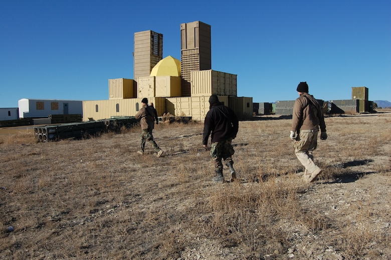 Airburst Range members walk to village in preparation for the close air support scenario.  The team acted as opposing forces for the 13th Air Support Operations Squadron Joint Termainal Attack Controller training.