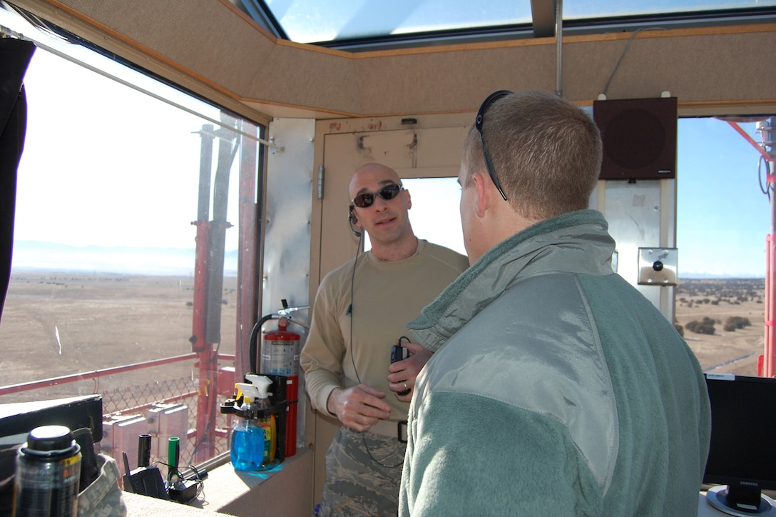Maj. John Stevenson, the Airburst Range Commander, briefs an observing Army 1st Lt. about the upcoming scenario from the Airburst Range Tower.
