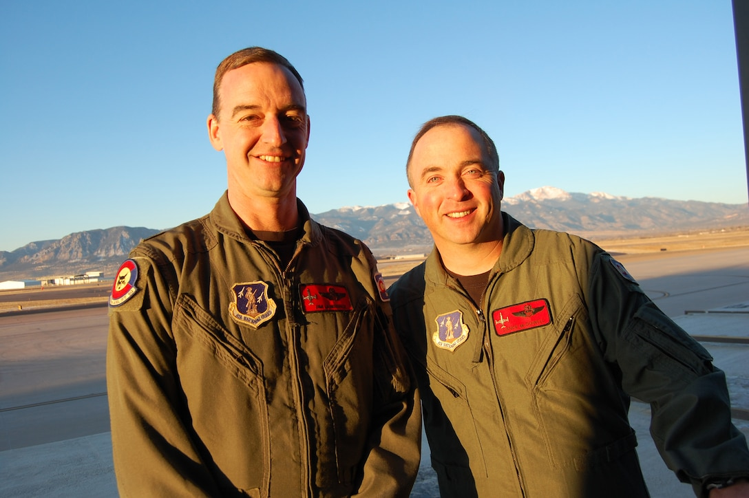 Lt. Col. Jim Lawrence (left) and Lt. Col. Charles McDowell (right), 200th Airlift Squadron pilots, have more than 12,000 of combined flying time.