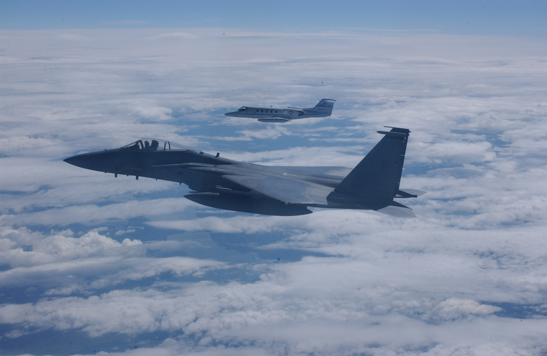 A U.S. Air Force F-15 Strike Eagle and C-21 perform a mission near Elmendorf Air Force Base, Alaska, August 15, 2005, during Northern Edge 2005. Alaska Shield/Northern Edge 2005 is the largest homeland defense/homeland security exercise ever conducted in Alaska--the first opportunity within the state to exercise an integrated local, state and federal government response to a series of simulated emergencies including natural disasters, terrorist attacks and mass casualty scenarios. (U.S. Air Force  photo by Staff Sgt. Shane Heiser) Released