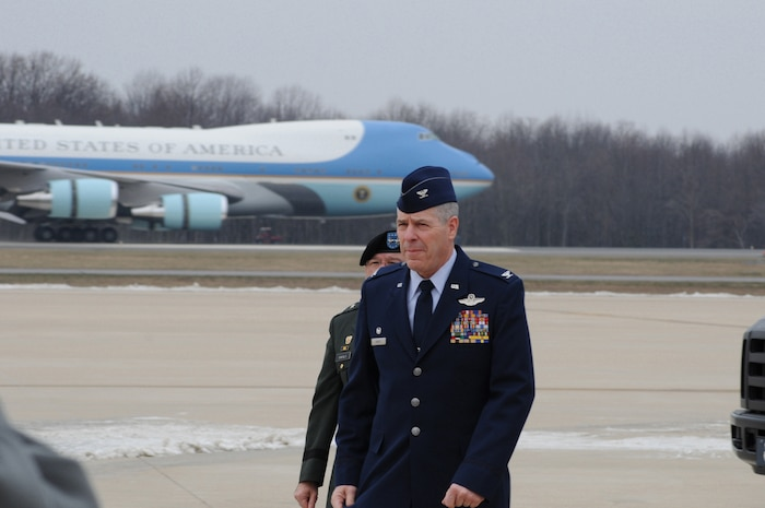 Colonel Jonathan Groff, commander, 166th Airlift Wing, Delaware Air National Guard is framed by Air Force One as he walks to the greeting area awaiting the arrival of President Barack Obama and first lady Michelle Obama at the New Castle Air Base, Del. Walking just behind Col. Groff is Maj. Gen. Francis Vavala, adjutant general, Delaware National Guard. The President was in Delaware to attend funeral services for the mother of Vice President Joseph R. Biden, Jr., a Delaware resident. (U.S. Air Force photo/Master Sgt. Keith R. Strouss)