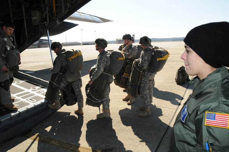 Load Master Senior Airman Laura Kruse observes the Army Rangers loading on the C-130. For the 107th Airlift Wing's first Army Ranger jump training operation. (AF Photo/Senior Master Sgt. Ray Lloyd)