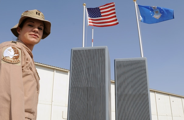 Capt. Hillary Wykes, a KC-10 Extender pilot with the 908th Expeditionary Air Refueling Squadron, stands by the 380th Air Expeditionary Wing's Sept. 11, 2001, memorial at a non-disclosed base in Southwest Asia on Jan. 13, 2010. Captain Wykes is a six-year Air Force veteran and recently completed her 100th combat sortie.  On Sept. 11, 2001, Captain Wykes was a flight attendant for United Airlines.  She said those events changed her life and led to her joining the military and becoming a pilot. Captain Wykes is deployed from the 9th Air Refueling Squadron at Travis Air Force Base, Calif., and her hometown is Plano, Ill. (U.S. Air Force Photo/Tech. Sgt. Scott T. Sturkol/Released)