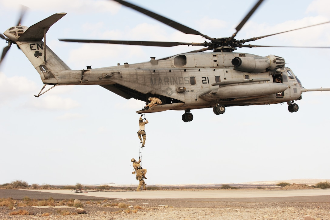 Air Force pararescuemen conduct a combat insertion and extraction exercise from a Marine CH-53 Sea Stallion helicopter in Djibouti, Africa, Jan. 5, 2010. The helicopter is attached to Heavy Marine Helicopter Squadron 464, and the two units are deployed to Combined Joint Task Force-Horn of Africa.  (U.S. Air Force photo/Master Sgt. Jeremiah Erickson)