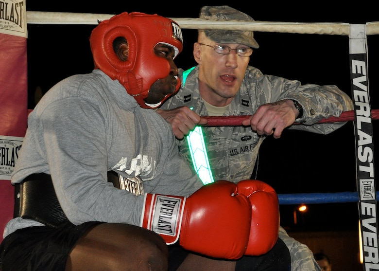 """Chaplain (Capt.) Curt Cizek pumps up one of his """"Bucca Boxing"""" trainees at Camp Bucca, Iraq.  Chaplain Cizek was involved in coaching, refereeing, and judging the boxing events."""
