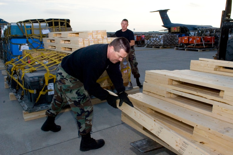 Tech. Sgt. Kenny Smith and Tech. Sgt. Jody Miller stack dunnage on top of a pallet on January 15, 2010 at the 167th Airlift Wing.  The air base in Martinsburg, W.Va, was transformed Janunary 14 into a staging area for more than 332,000 pounds of supplies bound for the airport at Port-au-Prince, Haiti. Hundreds of thousands of pounds more are expected to be palletized at the base for shipment to Haiti in the coming days. (U.S. Air Force photo by Emily Beightol-Deyerle)