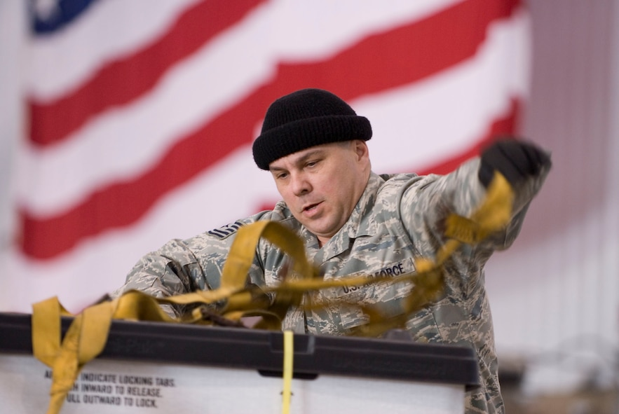Tech. Sgt. Darryl LeMaster stretches cargo netting over a pallet of medical supplies on January 15, 2010 at the 167th Airlift Wing. The air base in Martinsburg, W.Va, was transformed Janunary 14 intoa staging area for more than 332,000 pounds of supplies bound for the airport at Port-au-Prince, Haiti. Hundreds of thousands of pounds more are expected to be palletized at the base for shipment to Haiti in the coming days. (U.S. Air Force photo by MSgt Emily Beightol-Deyerle)