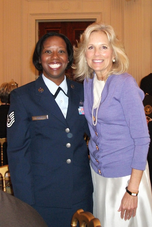 WASHINGTON -- Tech. Sgt. April M. Sharpe, the NCOIC of the client service center at The I.G. Brown Air National Guard Training and Education Center at McGhee Tyson ANGB, Tenn., poses with Dr. Jill Biden, wife of Vice President Joe Biden, at the White House during an event to honor women in the military, Nov. 18, 2009.  Tech. Sgt. Sharpe was one of four female enlisted members from the National Guard Bureau selected to attend the event hosted by First Lady Michelle Obama.  (U.S. Air Force photo by Chief Master Sgt. Chris Muncy)
