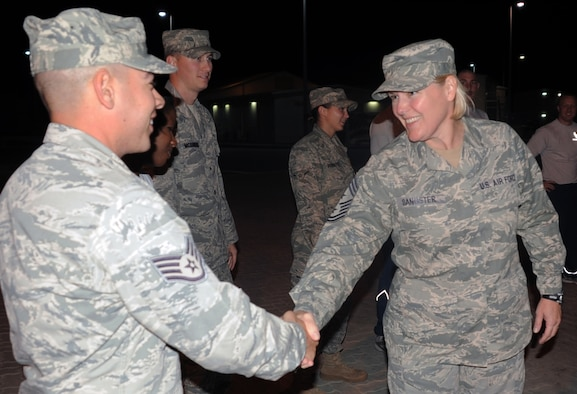 Chief Master Sgt. Suzan K. Sangster, command chief master sergeant for the 380th Air Expeditionary Wing, greets members of the wing's volunteer honor guard Jan. 14, 2009, at a non-disclosed base in Southwest Asia.  Chief Sangster is a 27-year veteran of the Air Force and is the Air Force's only female command chief master sergeant serving in a deployed AEW in the U.S. Central Command area of responsibility. Chief Sangster's hometown is Cedar Springs, Mich.  (U.S. Air Force Photo/Tech. Sgt. Scott T. Sturkol/Released)