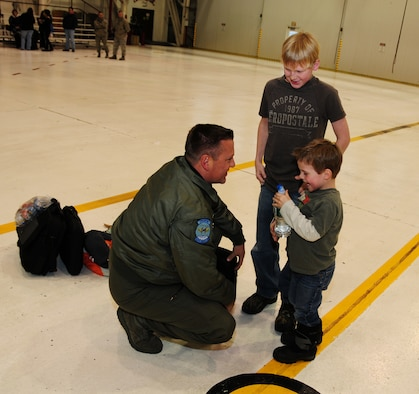 NIAGARA FALLS AIR RESERVE STATION, NIAGARA FALLS, NY-- Senior Master Sgt Aaron Achenbach is reunited with sons Aidan and Andrew, January 16. (U.S. Air Force photo by Staff Sgt Stephanie Clark)