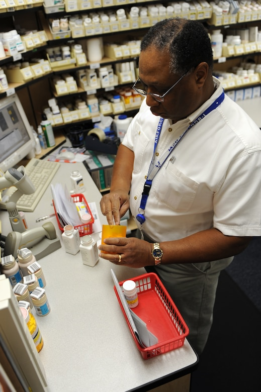 WHITEMAN AIR FORCE BASE, Mo. - Ernie Carpenter, 509th Medical Group civilian pharmacy technician, reviews filled prescriptions to ensure the correct amount of medicine is given and double checks the information on the bottle, Jan. 15, 2010. (U.S. Air Force photo by Airman 1st Class Carlin Leslie) (Released)