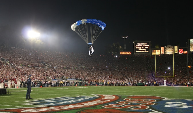 Cadet 1st Class David Leibrand soars into the Rose Bowl in Pasadena, Calif., before the BCS National Championship game between the Alabama Crimson Tide and the Texas Longhorns Jan. 8. Cadet Leibrand, a member of the Wings of Blue Air Force Parachute Demonstration Team, is a native of Scobey, Mont. (U.S. Air Force photo/Tech. Sgt. Kenny Kendrick)
