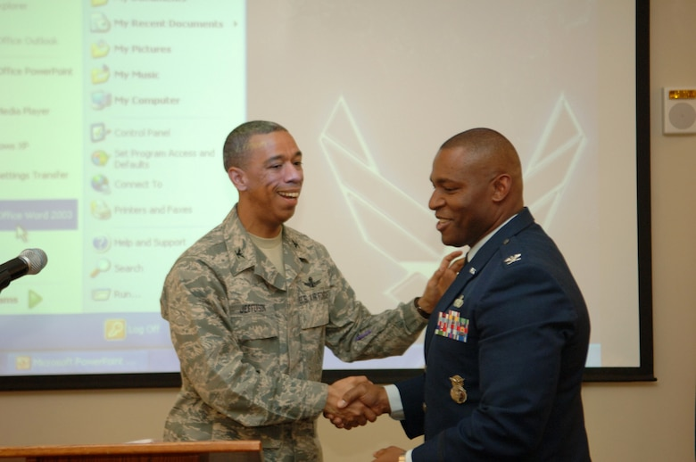 BUCKLEY AIR FORCE BASE, Colo. -- Col. Vincent Jefferson, 460th Mission Support Group commander, congratulates Col. Gerald Curry, Headquarters Air Force Space Command director of security forces on a well-made speech. Colonel Curry was at the Buckley Air Force Base Chapel annex celebrating Dr. King's legacy. (U. S. Air Force photo by Tech. Sgt. Shirley Henderson)