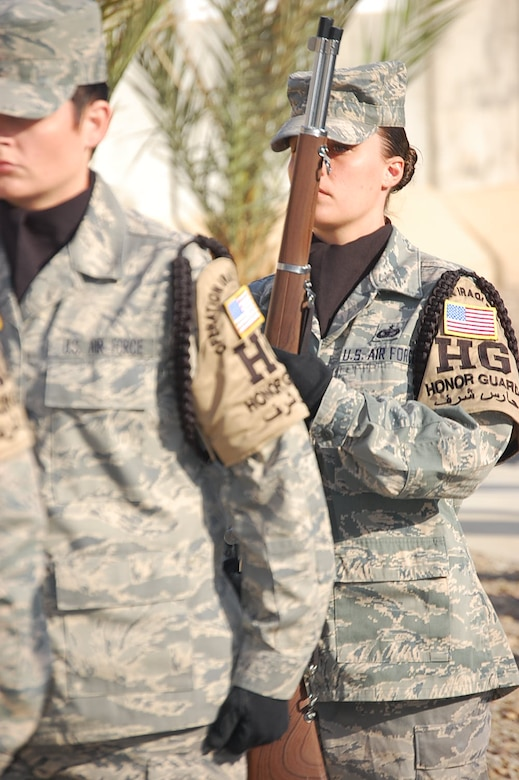SOUTHWEST ASIA - Staff Sgt. Nichole Gladkowski, deployed from the 460th Security Forces Squadron at Buckley Air Force Base, Colo., carries a rifle as honor guard NCO in charge at her deployed location. Sergeant Gladkowski performs her honor guard details in addition to her primary duties as a security forces Defender. (U.S. Air Force photo)