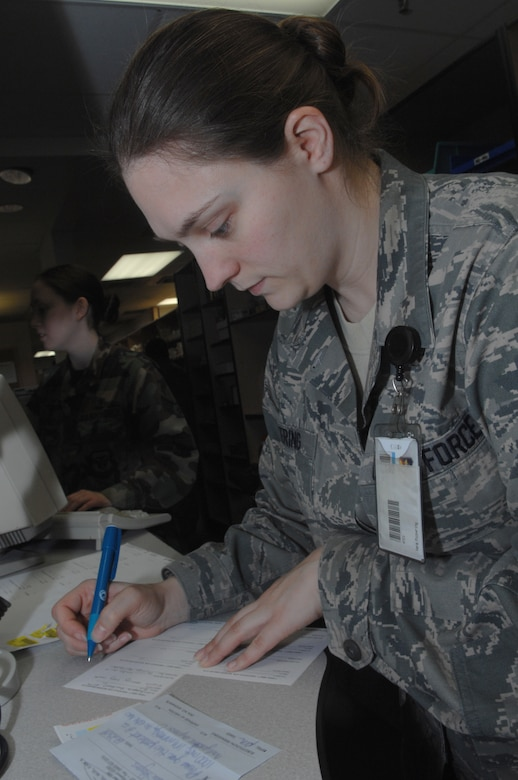WHITEMAN AIR FORCE BASE, Mo., - Staff Sgt. Vera Pickering, 509th Medical Group pharmacy technician, fills a patient's prescription by hand during a power-outage here Jan. 20, 2010. Hand-writing a prescription is part of the pharmacy's back-up contingency plan, if their computers become unavailable, in order to keep their mission going uninterrupted. The Whiteman Pharmacy fills 350-700 prescriptions daily. (U.S. Air Force photo/Senior Airman Jessica Mae Snow) (Released)