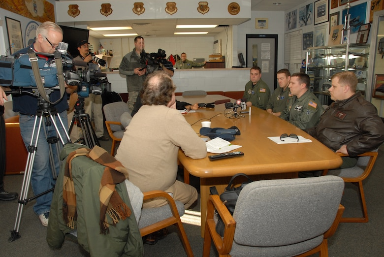 Members from the 107th New York Air National Guard and members from the 914th Air Force Reserves talk to the local media upon arriving home. The members had just completed a tour, delivering aid to Haiti. (From left to right) Staff Sgt. Brian Waite, 107th C-130 flight engineer, Capt. Justin Pautler, 107th C-130 pilot, Capt. Richard Konopczynsky, 914th C-130 pilot and Tech Sgt. Rick Ackley, 914thC-130 flight engineer. (U.S. Air Force Photo/ Tech Sgt. Cathy Perretta)