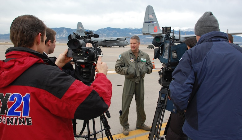 Maj. Brad James, 731st Airlift Squadron pilot, meets with Colorado Springs media before departing Peterson Air Force Base Jan. 22 in support of Operation Coronet Oak. Two C-130 Hercules and approximately 50 Air Force reservists from 302nd Airlift Wing left Colorado to fly missions out of Puerto Rico in support of Haitian relief efforts. (Air Force Photo/Tech. Sgt. Daniel Butterfield)