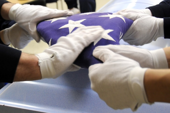"EGLIN AIR FORCE BASE, Fla. –  Members of Eglin's Honor Guard practice the ceremonial folding of the flag for military funerals, Jan. 20. ""Working in a support role Airmen can lose their sense of perspective as to why they serve,"" said Senior Master Sgt. Thomas Walker, 96th Air Base Wing, on what it means to serve in the honor guard.  ""Being able to step outside the career field and daily, mundane taskings and serve a higher purpose gives them a greater sense of duty, commitment and perspective that pays huge dividends when they return to their normal job.  Ask any Airmen who has ever served in the Honor Guard and they will tell you it was one of the greatest experiences of their career (whether they were volunteers or volun""tolds"").  The sense of fulfillment, job satisfaction and pride are unmatched.""   The next honor guard rotation begins Feb. 1 through July 31.  Deadline to sign-up is Jan. 25.  To get involved and volunteer contact your first sergeant or chief. (U.S. Air Force photo/ Airman 1st Class Anthony Jennings)"