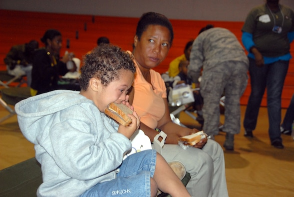 A young Haitian boy enjoys a sandwich from a box lunch prepared by the 482nd Services Sqaudron, Homestead Air Reserve Base, Fla. The 482nd is preparing 500-800 box lunches a day in support of Operation Unified Response. (Air Force photo/Master Sgt. Chance Babin)