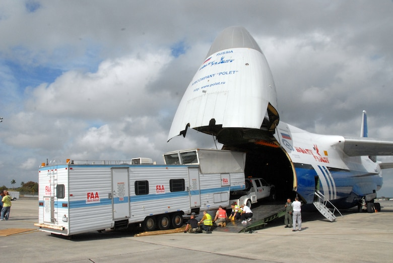A mobile air traffic control tower is loaded onto a Russian Antonov An-124 cargo plane at Homestead Air Reserve Base, Fla., Jan. 21, 2010. The mobile air traffic control tower will increase the efficiency of aid being delivered to earthquake victims in Haiti. (U.S. Air Force photo/Tech. Sgt. Brian Bahret)