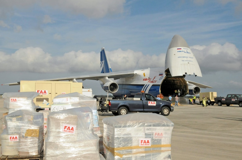 Members of the Federal Aviation Administration load a mobile air traffic control tower, generators, food, clothing and water aboard a Russian Antonov An-124 cargo plane en route to Haiti. The tower will be used to help improve the efficiency of aircraft flying in and out of Haiti. The supplies will be used to support Operation Unified Response. (U.S. Air Force photo/Master Sgt. Sabrina Johnson)