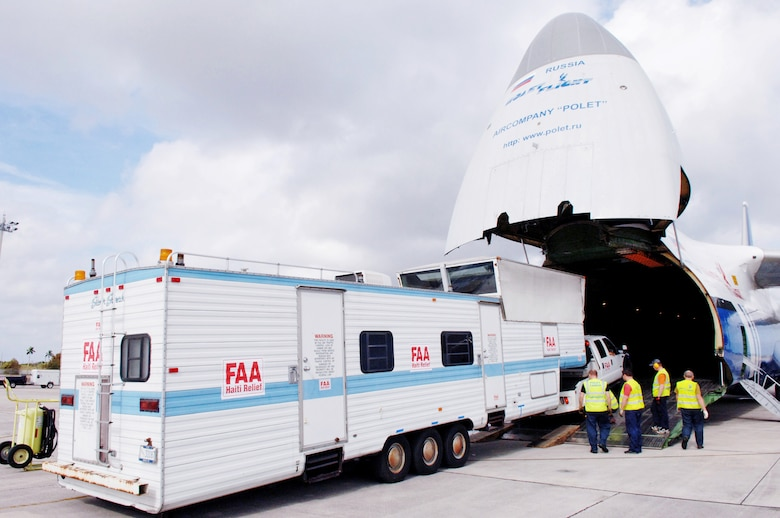 A mobile air traffic control tower is loaded onto a Russian Antonov An-124 cargo plane at Homestead Air Reserve Base, Fla., Jan. 21, 2010.  The mobile air traffic control tower will increase the efficiency of aid being delivered to earthquake victims in Haiti. (U.S. Air Force photo/Tech. Sgt. Andy Bellamy)