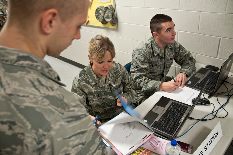 Staff Sgt. Holly Moore, a financial services technician in the 123rd Airlift Wing, reviews mobility records Oct. 25 as part of the Personnel Deployment Function for a mobility exercise held at the Kentucky Air National Guard Base in Louisville, Ky. (U.S. Air Force photo by Maj. Dale Greer)