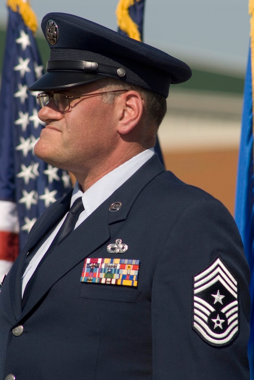 """123rd Airlift Wing Command Chief Master Sgt. Tommy Downs, shown here during a 2007 change-of-command ceremony, was remembered as the epitome of """"service before self"""" at a memorial service for him held Dec. 17, 2009, at the Kentucky Air National Guard Base in Louisville, Ky. Chief Downs died Dec. 12 from complications of pancreatitis. (U.S. Air Force photo by Tech. Sgt. Dan Clare)"""