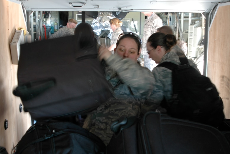 Staff Sgt. Gina Cerquozzi moves bag after bag of personal gear after she and members of the Air Force Reserve's 302nd Airlift Wing arrived Jan. 23 at Muniz Air Base, Puerto Rico. Approximately 50 Airmen from the 302nd AW are deployed to the U.S. territory in support of Air Expeditionary Force Coronet Oak and its involvement with earthquake relief operations in Haiti. The Colorado-based AF Reserve Airmen are expected to be at Muniz Air Base for two weeks, assigned to the 35th Expeditionary Airlift Squadron. Sergeant Cerquozzi is a avionics technicians from the 302nd Maintenance Squadron. (U.S. Air Force photo/Staff Sgt. Stephen J. Collier)