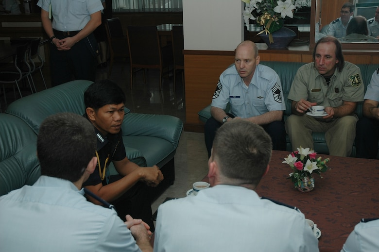 Chief Master Sgt. James D. Riley, chief loadmaster with the Air Force Reserve's 302nd Airlift Wing, listens to Group Captain Nimit Kraigratoke, deputy director, Special Task Division, Royal Thai Air Force discuss aerial firefighting in Thailand.  Seven members of the 302 AW traveled to Don Muang Royal Thai Air Force Base, Thailand to provide expert training to RTAF members on safe and effective Modular Airborne Firefighting System operations.  This event marks the first time the Air Force Reserve has sent delegates to train a foreign Air Force on use of the MAFFS equipment.  Accompanying the Air Force Reserve contingent is Mr. David P. Stickler, leadplane and instructor pilot with the U.S. Forest Service. (U.S. Air Force photo/Capt. Jody L. Ritchie)