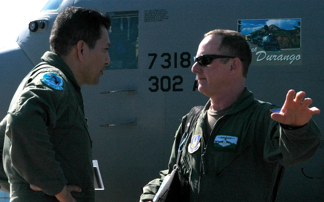 "Lt. Col. Kelvin Anderson (right) coordinates with Col. Julio ""Zorro"" Lopez, 35th Expeditionary Airlift Squadron commander, after he and members of the Air Force Reserve's 302nd Airlift Wing arrived Jan. 23 at Muniz Air Base, Puerto Rico. Approximately 50 Airmen from the 302nd AW are deployed to the U.S. territory in support of Air Expeditionary Force Coronet Oak and its involvement with earthquake relief operations in Haiti. The Colorado-based AF Reserve Airmen are expected to be at Muniz Air Base for two weeks. Colonel Anderson is the mission commander for the deployed 302nd AW Airmen. (U.S. Air Force photo/Staff Sgt. Stephen J. Collier)"
