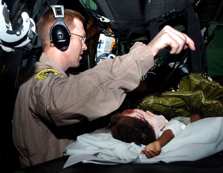 Maj. John Lynch, 88th Medical Group Critical Care Air Transport Team, prepares a 3-year-old earthquake victim for aeromedical evacuation from Port-au-Prince, Haiti to Fort Lauderdale, Fla. (U.S. Air Force photo by 2nd Lt. Anastasia Wasem/Released)