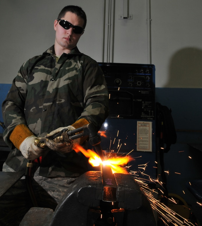 SPANGDAHLEM AIR BASE, Germany -- Senior Airman James Hurst, 52nd Equipment Maintenance Squadron, cuts metal with an oxyacetylene rig Jan. 22 in the metals technology welding room. This process is necessary to cut metal to a size small enough for disposal. (U.S. Air Force photo/Airman 1st Class Nick Wilson)