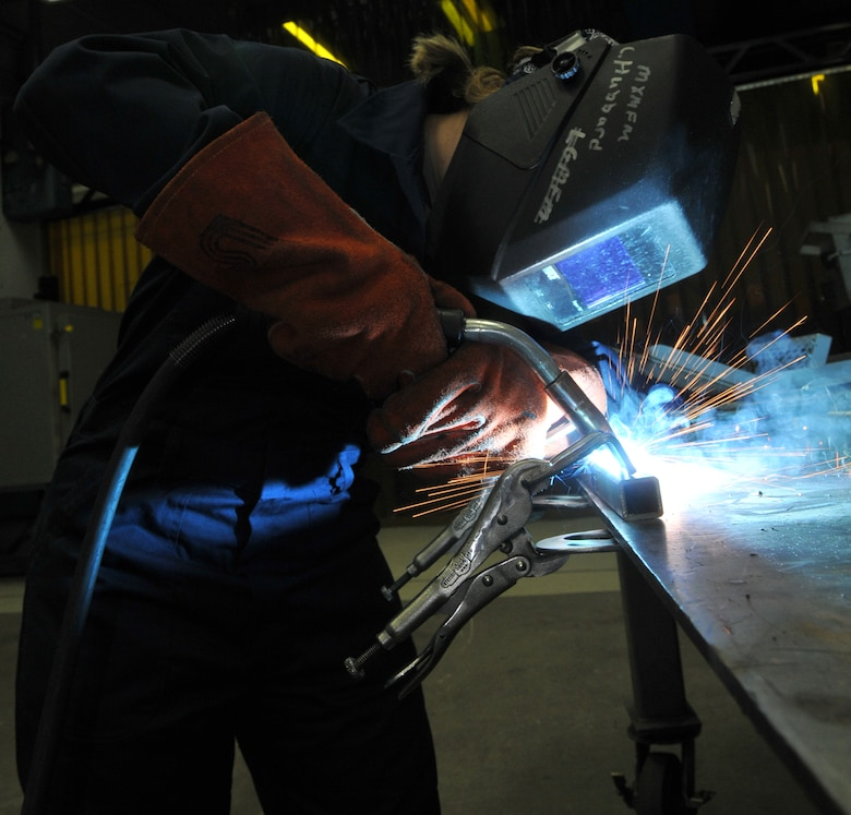 SPANGDAHLEM AIR BASE, Germany -- Airman 1st Class Abigail Dressler, 52nd Equipment Maintenance Squadron, uses metal inert gas to weld a piece of equipment Jan. 22 in the metals technology welding room. This is done to fabricate aircraft support equipment such as stands for aircraft maintenance, power units and air conditioning units. (U.S. Air Force photo/Airman 1st Class Nick Wilson)