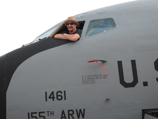 Kid Rock looks out from a Nebraska Air National Guard KC-135R Stratotanker on December 6, 2009 while doing a USO show for deployed troops at Al Udeid AB, Qatar. The Stratotanker was one of two 155th Air Refueling Wing aircraft deployed to Al Udeid, AB. (Nebraska Air National Guard photo by Capt. Lloyd Blessington)