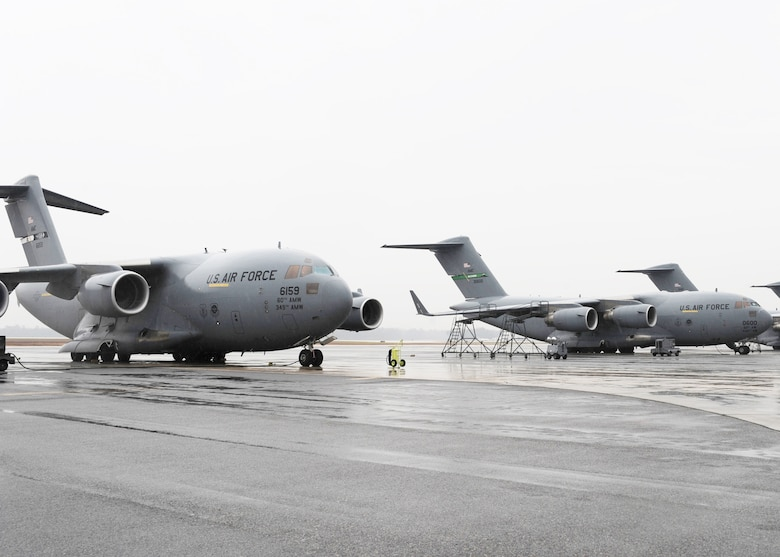 Several C-17 aircraft sit on the Charleston AFB flightline here Jan. 21. The planes were from bases such as Elmendorf, Alaska, Travis, Calif., Hickam, Hawaii and McChord, Wash. The Air Force's airlift capability enables the U.S. to respond immediately to any disaster domestically or worldwide. the U.S. is the only country with an aircraft fleet capable of providing this type of response.  (U.S. Air Force photo/Senior Airman Katie Gieratz)(RELEASED)