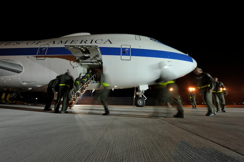 An aircrew from the 1st Airborne Command and Control Squadron board an E-4B at Offutt Air Force Base, Neb., during a simulated alert mission. The E-4B serves as the National Airborne Operations Center for the president, secretary of defense and chairman of the Joint Chiefs of Staff. The aircraft passed a significant milestone this month by sitting alert constantly for more than 35 years. (U.S. Air Force photo/Lance Cheung)