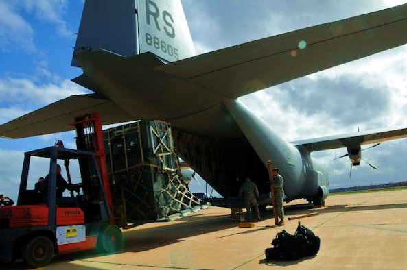 MARRAKECH, Morocco -- Cargo is removed from a C-130J Super Hercules on the Marrakech, Morocco flightline Jan. 23. The C-130J, from the 37th Airlift Wing at Ramstein Air Base, Germany, arrived for the Morocco Aeroexpo 2010. U.S. Air Force units based in the states and Europe have arrived for the event to showcase their aircraft, learn from military counterparts and building lasting relationships with African nations. Counterparts from more than 40 countries are scheduled to attend the Aeroexpo. (U.S. Air Force photo by Staff Sgt. Stefanie Torres)