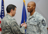 NELLIS AIR FORCE BASE, Nev.-- Col. John P. Montgomery, 98th Range Wing commander, presents Chief Master Sgt. Mark T. Darden, 98th Range Wing superintendent, with a Bronze Star Jan. 14 for his meritorious achievement while deployed to Joint Base Balad, Iraq and Al Udeid Air Base, Qatar.  Chief Darden served as the Chief Enlisted Manager for the 557th Expeditionary RED HORSE Squadron, 9th Air Expeditionary Task Force from Sep. 13, 2008 to April 1, 2009.  (U.S Air Force photo by Staff Sgt Taylor Worley)